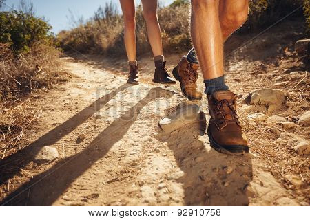Hikers Walking On The Country Path