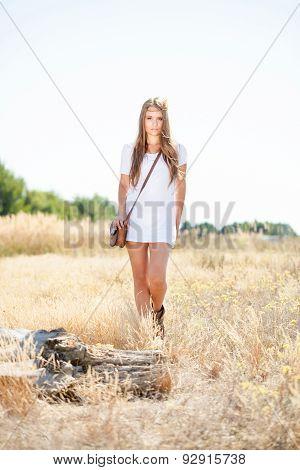 Beautiful Hippie Looking Girl Approaching A Tree Stump