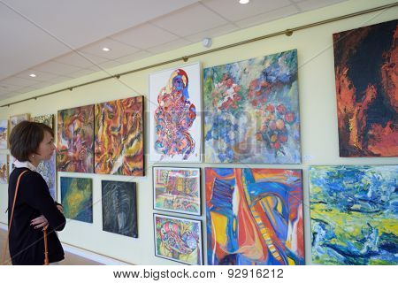 ST. PETERSBURG, RUSSIA - JUNE 7, 2015: Spectator at first exhibition of the project