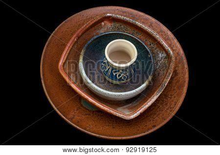 Ceramic Bowls Against Black