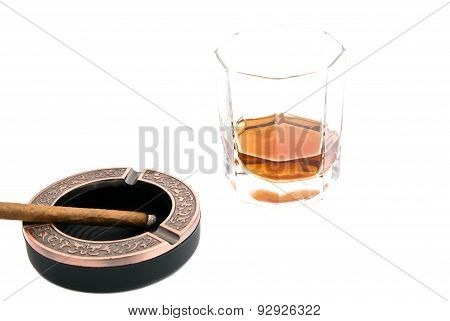 Cigarillo In Ashtray And Glass Of Whiskey