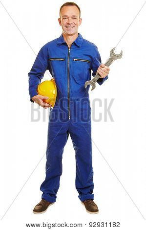 Smiling isolated full body builder with yellow helmet and boiler suit