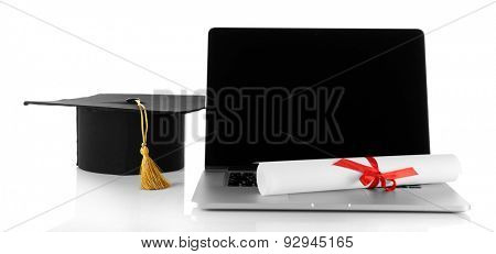 Graduation cap with laptop and diploma isolated on white