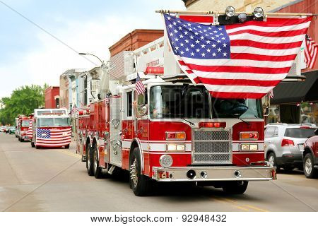 Fire Trucks With American Flags At Small Town Parade