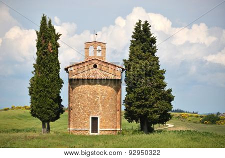 Little chapel surrounded by cypress trees. Tuscany, Italy poster