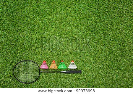 Badminton racket with color shuttlecocks