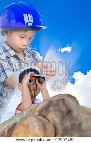 Future Engineer, Boy Lying Prone On A Boulder And Using Binoculars