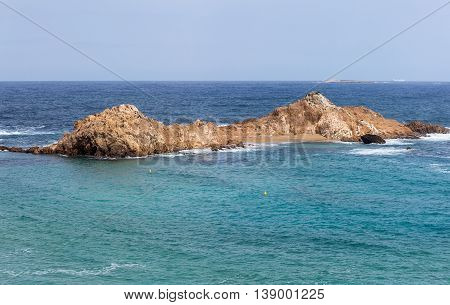 small islet in Turquoise water Mediterranean Sea