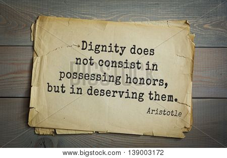 Ancient greek philosopher Aristotle quote. Dignity does not consist in possessing honors, but in deserving them.