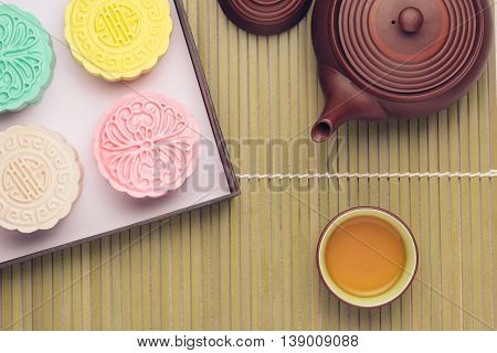Mooncake and tea Chinese mid autumn festival food. Angle view from above