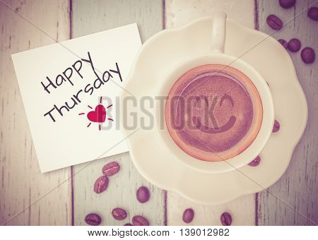 Happy Thursday on paper note with coffee cup on table