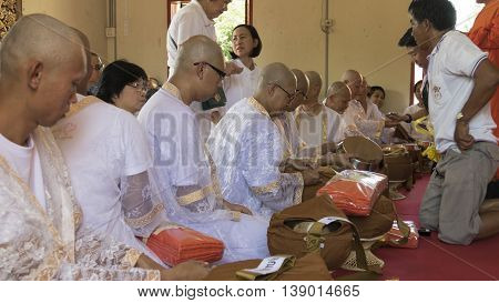Man Who Will Become Buddhism Monk Sitting And Waiting For Ordination Ceremony