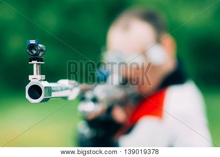 Man on free rifle triaing outdoors, selective focus