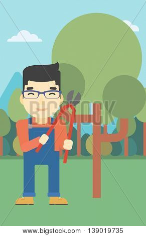 An asian farmer working with a pruner in the garden. Young man pruning branch. Gardener trimming branches in garden. Vector flat design illustration. Vertical layout.