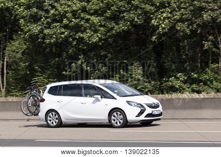 FRANKFURT GERMANY - JULY 12 2016: Third generation Opel Zafira Tourer compact MPV on the highway in Germany