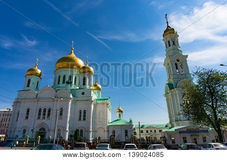 Rostov on Don Russia - Aug 29 2013: Cathedral of the Most Holy Mother of God and belltower campanile. Words in Russian on the building: Store Orthodox book. Religion theme background copy space