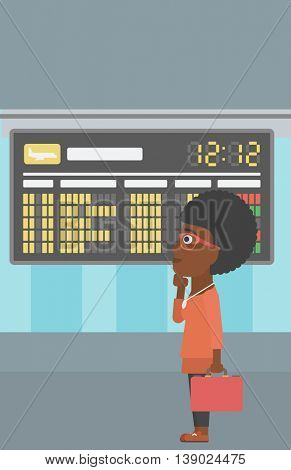 An african-american woman with briefcase looking at departure board at the airport. Passenger standing at the airport in front of departure board. Vector flat design illustration. Vertical layout.