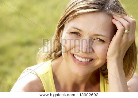 Portrait of young woman relaxing in countryside