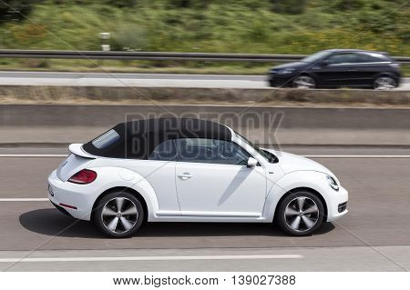 FRANKFURT GERMANY - JULY 12 2016: Volkswagen Beetle Convertible driving on the highway in Germany