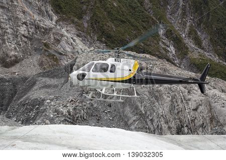 Franz Josef Glacier, New Zealand - March 22, 2015: A Helicopter landing on Franz Josef Glacier