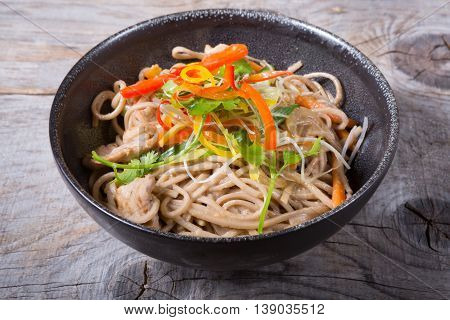 Soba wok noodles with meat and herbs
