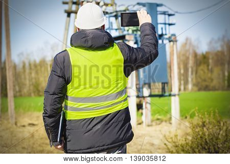 Electrician inspect the power lines technical condition