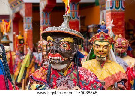 LAMAYURU INDIA - JUNE 13 2015: Unidentified buddhist lamas dressed in mystical mask dancing Tsam mystery dance in time of Yuru Kabgyat Buddhist festival at Lamayuru Gompa Ladakh North India