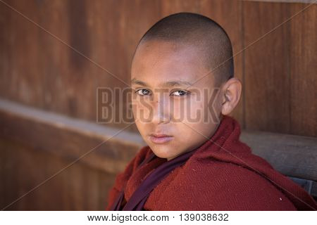 INLE LAKE MYANMAR - JANUARY 13 2016: Unidentified young monk in buddhist monastery