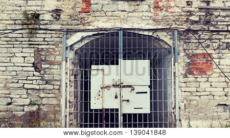 imprisonment, building concept - old prison gate