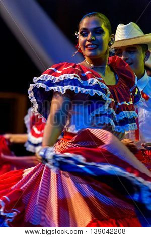 ROMANIA TIMISOARA - JULY 9 2016:Young dancer from Costa Rica in traditional costume present at the international folk festival