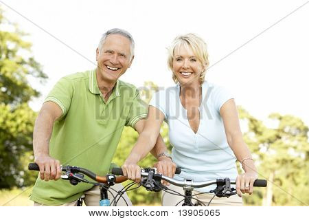 Mature couple riding bikes