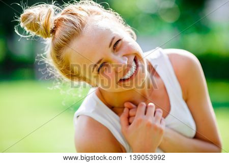 Closeup portrait of beautiful young blond girl with beam on head. Woman laughing and enjoying life, real emotions