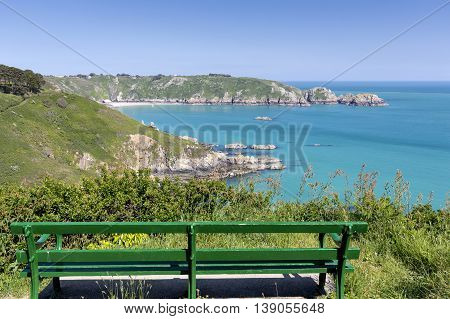 Bench overlooking south coast of Guernsey island, UK, Europe