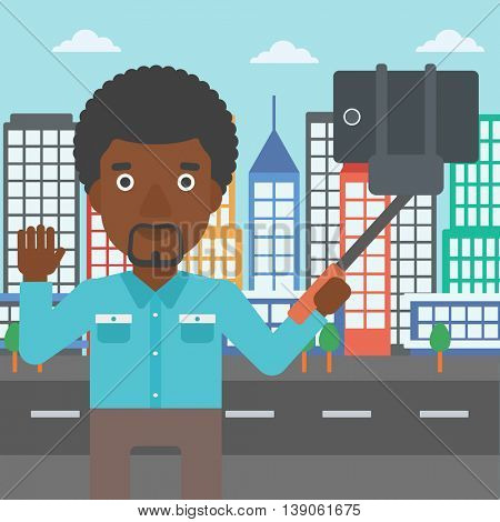 An african-american man making selfie with a selfie-stick. Man taking photo with cellphone and waving on a city background. Vector flat design illustration. Square layout.
