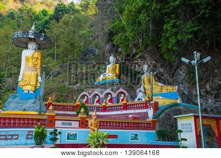 Amazing View Of Lot Buddhas Statues And Religious Carving On Limestone Rock In Sacred Cave. Hpa-an,