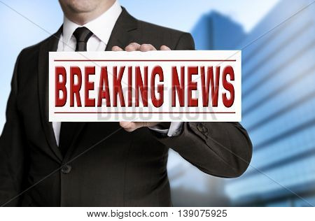 Breaking News Sign Is Held By Businessman
