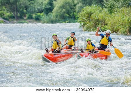 Yappy family of four river rafting on the catamaran