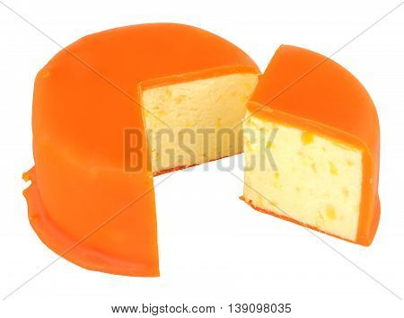 Orange wax covered mango and ginger Stilton cheese isolated on a white background