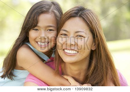 Mother And Daughter Enjoying Day In Park