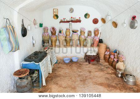 MATMATA TUNISIA - SEPTEMBER 17 2012 : The interior of kitchen in original troglodyte home in berber village in Matmata Tunisia. Matmata is the largest region of the troglodyte communities.