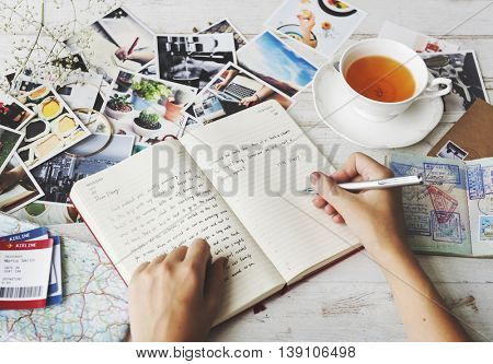 Hands Writing Travel Journal Tea Concept