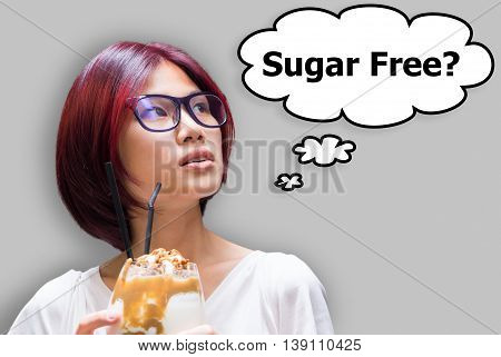Japanese girl thinking if her drink is sugar free or not