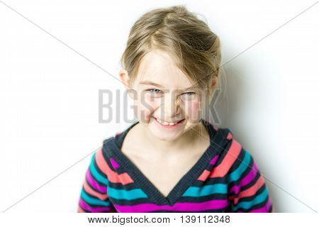 A cute cheerful  little girl portrait, isolated on gray background