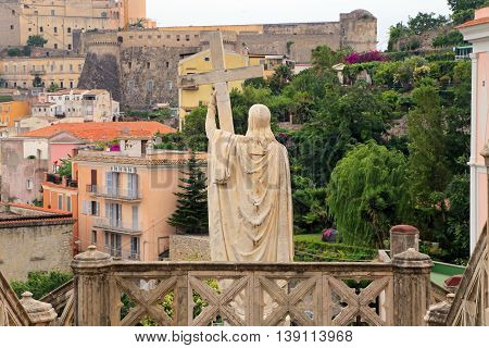 Jesus Christ holds passion cross marble statue in Gaeta southern Italy