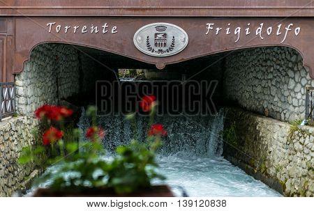 Frigidolfo River Flows Inside Ponte Di Legno Under A Bridge
