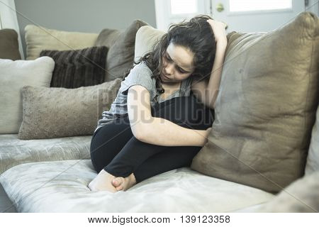 A nExpression of lonely female teenager at home