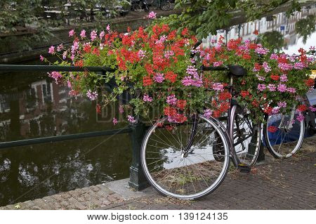 City center and bicycle parked on a bridge in Amsterdam Netherlands.