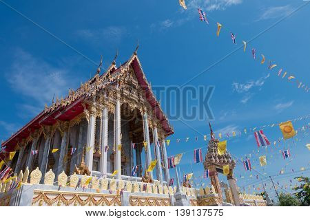 Samutprakarn, Thailand - July 19: Thai Buddhist decorate temple with Thailand flag and yellow Buddhism symbol flag to celebrating on Asalha Puja day or Asalha bucha Day before Khao Phansa day.