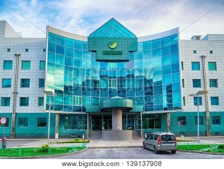 VELIKY NOVGOROD RUSSIA-JUNE 20 2016. The facade of modern office building of Sberbank - the largest bank in Russia - in Veliky Novgorod Russia