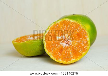 Orange Fruit With Half View Isolated On Wooden Board
